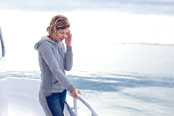 Seasick-woman-on-boat_Blog-image-template_600x400
