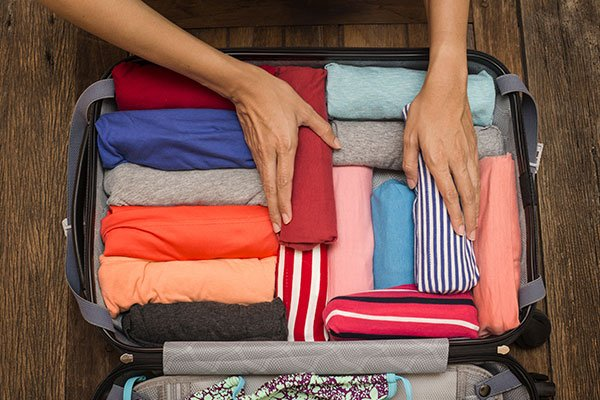 ymt-blog-how-to-pack-clothing-so-it-stays-wrinkle-free-rolling-clothes