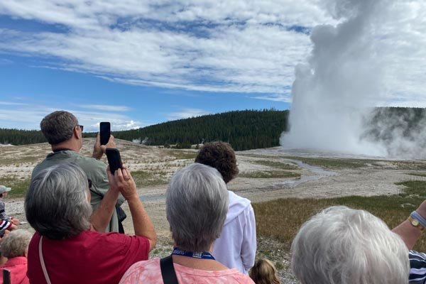 YMT Guests at Old Failthful Geyser Rocky Mountains Tour