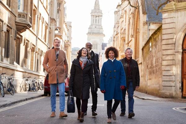FRIENDS WALKING DOWN A STREET IN EUROPE