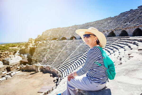 woman-in-ampitheater-ymt-vacations-ss_776772880