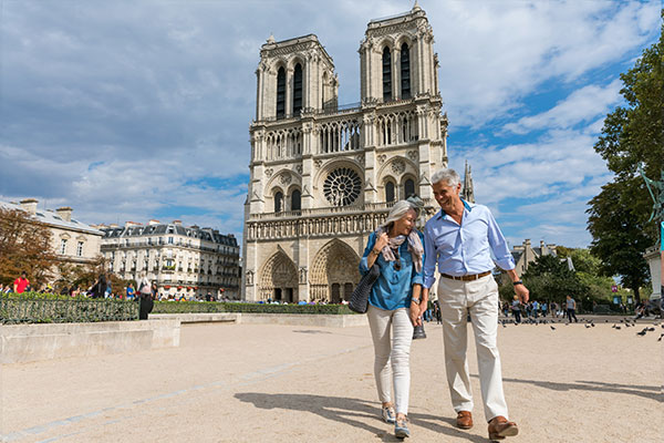 ymt-blog-benefits-of-taking-more-vacations-couple-enjoying-paris-france